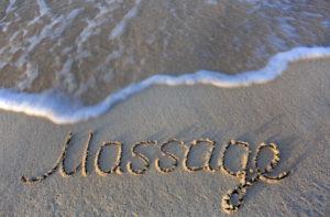 massage écrit sur le sable